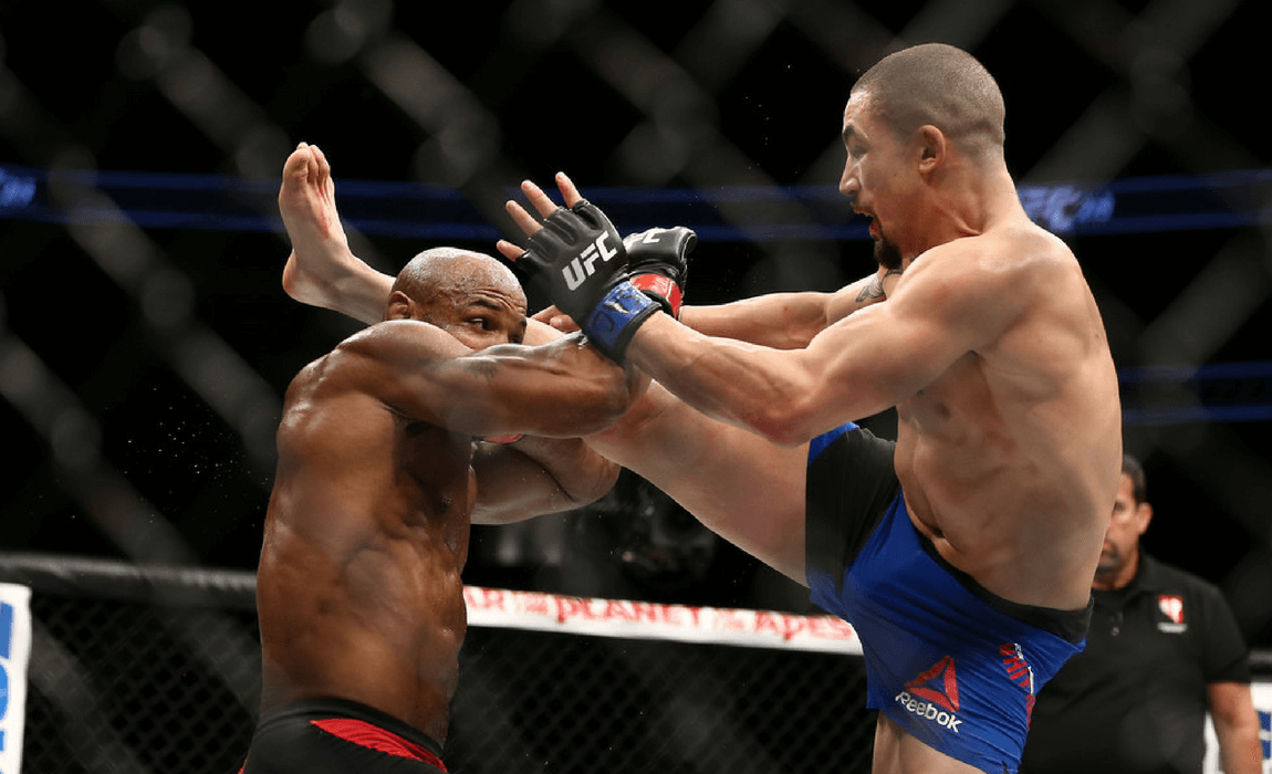 Robert Whittaker kicks Yoel Romero in their interim UFC middleweight championship bout during the UFC 213 event at T-Mobile Arena on July 9, 2017 in Las Vegas, Nevada. (July 7, 2017 - Source: Rey Del Rio/Getty Images North America)