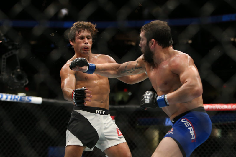 Jimmie Rivera punches Urijah Faber during the UFC 203 event