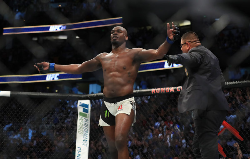Jon Jones celebrates after knocking out Daniel Cormier in their UFC light heavyweight championship bout during the UFC 214