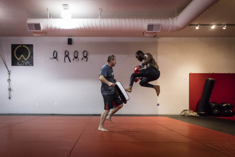 Jon Jones practices a flying oblique kick