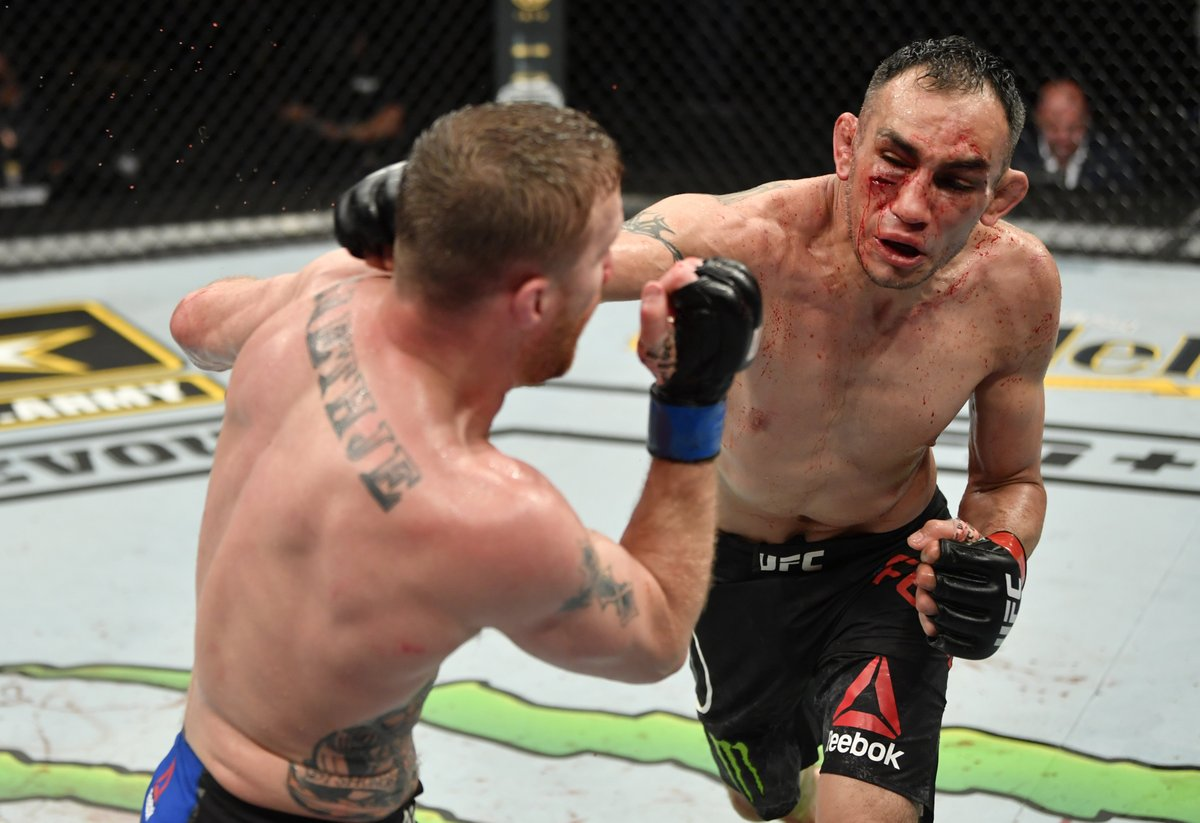 Tony Ferguson strikes Justin Gaethje at UFC 249